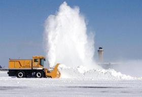 Plows at Kansas City International Airport may reprise this scene to clear runways.