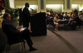 Kansas City Mayor Sly James takes the podium at Union Station, to commend yesterday's election results.  Truman Medical Center CEO, John Bluford, sits to his left, preparing to make his remarks.