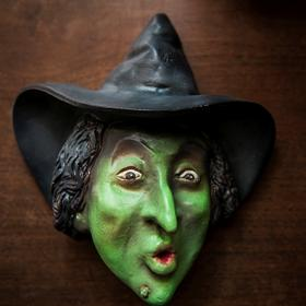An unusual item produced to promote the 1939 film, a Wicked Witch of the West String Holder.