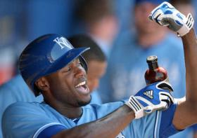 Kansas City Royals' Lorenzo Cain (6) adds the bottle of Billy Butler Hit A Ton rally sauce onto his arm muscle in the dugout after hitting a two run home run in the ninth inning to tie during a game against the Detroit Tigers on June 12, 2013, at Kauffman Stadium in Kansas City, Mo.