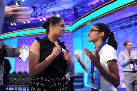 Vanya Shivashankar, right, talks with older sister Kavya after the final round of the 2013 Scripps national Spelling Bee in Washington, D.C., on Thursday, May 30, 2013. Kavya, who helped coach Vanya for this year's competition, won the Bee in 2009.