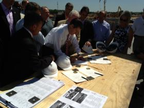 Gov. Sam Brownback signed the historic tax bill at the Prairie Fire construction site in Overland Park, Kan.
