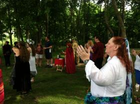 Members of Lushede Grove observe the summer solstice at Waterfall Park in Independence, Mo., on Sunday, June 16, 2013.