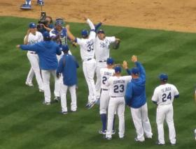 Pitcher James Shields high-fives third baseman Mike Moustakas after the Royals' win over at their home opener in April.