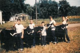 Horel, middle, still has fond memories of playing around the farm with his brothers and other neighborhood kids.
