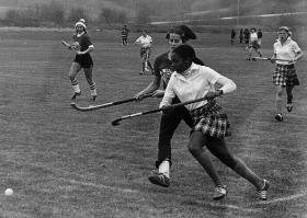A field hockey team after Title IX, 1977. One of the players is identified as Terri Dean.