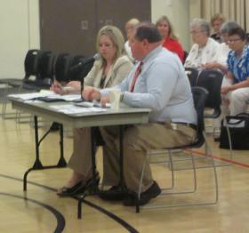 Brian Kinkade of Missouri's Department of Social Services explains Medicaid to a panel in Independence.