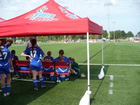 A coach talks to his team at halftime during the US Youth Soccer National Championships at the Overland Park Soccer Complex.