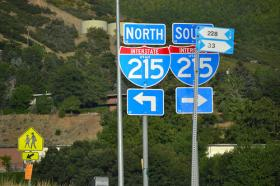 The interstate highway system makes road trips from state to state relatively hassle free. (Interstate highway signs in Utah.)