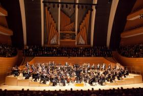 The Kansas City Symphony performs in Helzberg Hall at the Kauffman Center for the Performing Arts.