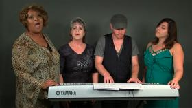 Bennie (Mandy Mook) receives comfort from close co-workers and dear friends, Lea (Lana Dealy) and Melanie (Victoria Barbee). With Chad (Tim Braselton) on keyboard.