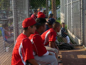 Angels players look on at the game from the dugout.