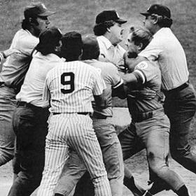 "Kansas City Royals player George Brett is held back by umpires after protesting the infamous ""pine tar"" bat call."