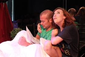 Actors Jake Walker and Diana Watts rehearse their lines, as a husband and wife in a sinking boat, at the Fishtank.