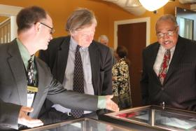 Michael Sweeney, the Archives' collection librarian; Crosby Kemper III, director of the Kansas City Public Library; and Allan Gray, Lee's Summit mayor pro tem, view some of the objects on display.