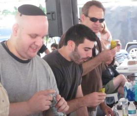 Competitors battle at the adult pickle-eating contest.