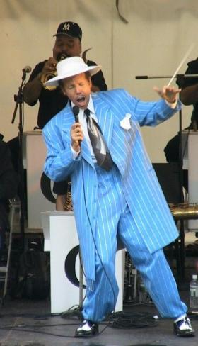 Performer sports a traditional Zoot suit.