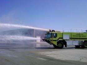 Special firetrucks spray water into a plane at KCI airport in Kansas City, Mo.