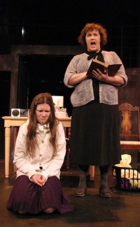 Chelsea Anglemyer and Tara Varney in a mother-daughter battle to the death in the musical 'Carrie.'