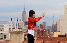 """Christian Jankowski, """"Rooftop Routine,"""" 2008, DVD and 20 hula-hoops, 4 min., 30 sec."""