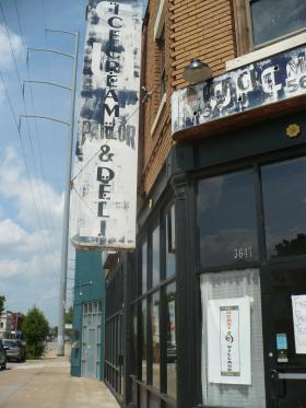 Uzazi Village is located on 37th and Troost, in what used to be a delicatessen. In the windows hang hand-drawn posters for Wednesday's breastfeeding clinic and clothing closet.