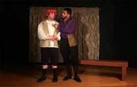 Aaron Gotzon (from left), as Bassanio, listens to Khalid Johnson, as Gratiano.