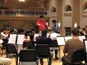 Aram Demirjian conducting with soloist Stefan Jackiw, April 2007.