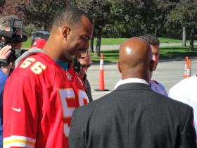 Kansas City Chiefs linebacker Derrick Johnson helped distribute meals Tuesday to area hunger agencies at Arrowhead Stadium.