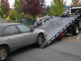 Looks like a tow job.  Could be a car theft.
