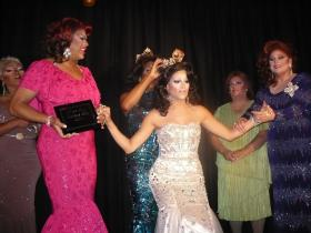 Miss Gay Kansas City 2013, Heidi Banks, is crowned on stage at Hamburger Mary's in Kansas City, Mo.