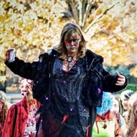 The Zombie Queen walks on stilts for Kansas City's annual Zombie Walk.