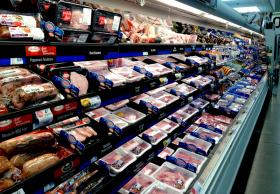 The pork cooler at a Hyvee grocery store in Columbia, Mo., is full of meat. New rules that just went into full effect force meatpackers to detail where much of this meat was born, raised and slaughtered.