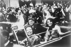 John F. Kennedy rides in the Nov. 22 Dallas motorcade, shortly before he was shot.