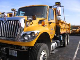 MoDOT trucks wait for plow attachments at the agency's Lees Summit depot.