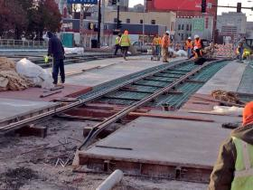 Workers began laying track in the Crossroads district of Kansas City.