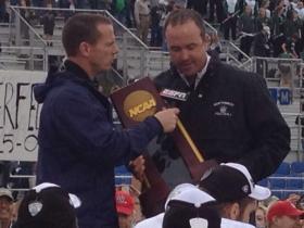 Northwest Missouri coach, Adam Dorrel with the national championship trophy.