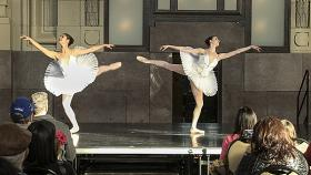 Meagan Swisher (from left)  and Morgan Sicklick dance onstage during a public performance at Union Station.