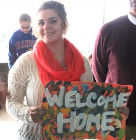 Vicki Sanders waiting for arrival of husband, Army Corporal Robert Sanders at KCI airport in Kansas City, Mo.