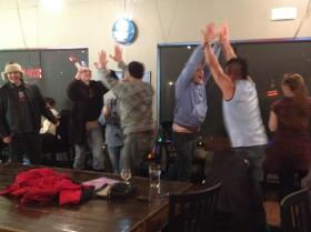 A jubilant crowd at the Bier Station in the Brookside neighborhood of Kansas City celebrates Sporting KC's win.