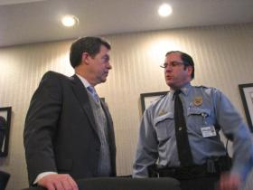 Gov. Sam Brownback talks with Capt. Doug Paresi of the Kansas City, Kan. Police Department. Paresi said the reconfigured Rainbow Mental Health Facility would give law enforcement a new option for dealing with mentally ill persons who otherwise might end up behind bars.