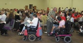 People with developmental disabilities gather along with advocates and caretakers at a pre-implementation meeting in Wichita in June 2012.