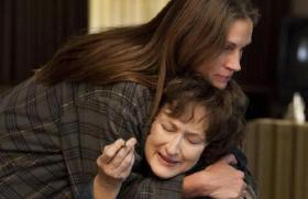 Meryl Streep (bottom) plays Violet Weston, the matriarch of a screwed up family, comforted - sort of - by her daughter Barbara (Julia Roberts).