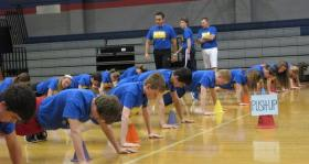 Seaman Middle School students in Topeka, Kan., demonstrate fitness routines in the gymnasium.