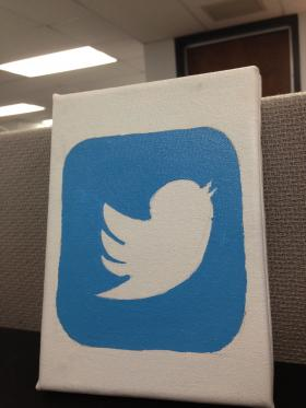 This painting of a Twitter logo by Ashley Raletz, the sister of KCUR Social Media Producer Alyson Raletz, sits on her desk in the station's newsroom.