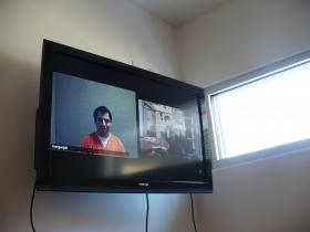 Edher Palafox talks with KCUR's Sylvia Maria Gross via video phone from the Missouri jail where he is being detained.