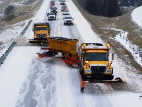 A tow-plow removes snow on a Missouri highway.