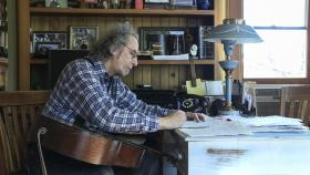 Musician Howard Iceberg composes in his office in his West Side home.