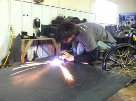 Hrabik works on a piece of metal in his shop in Sedgewickville, Mo. About 90 percent of his metal artwork is custom made.