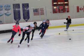 Members of the Kansas City Speed Skating team race around the ice at Line Creek Community Center