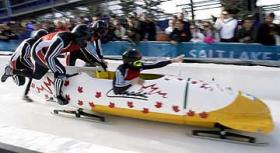 Competitors get a sprinting start before jumping into the bobsled and descending down the run.